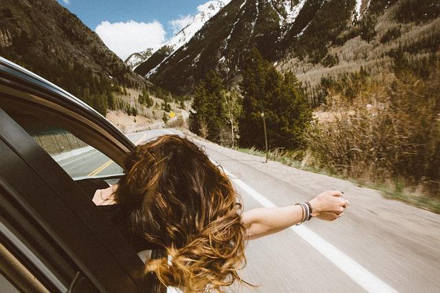 Woman in a rental car